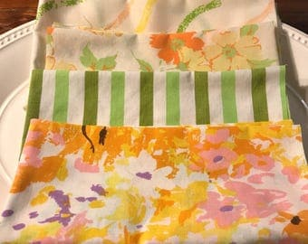 Four piece Vintage sheet fat quarter bundle. Orange, yellow, pink, green floral and stripe