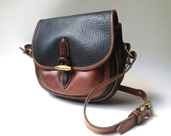 Dooney and Bourke vintage Distressed AWL Black and British Tan Leather Outback Crossbody Bag / Saddle Bag / Hipster Preppy Equestrian