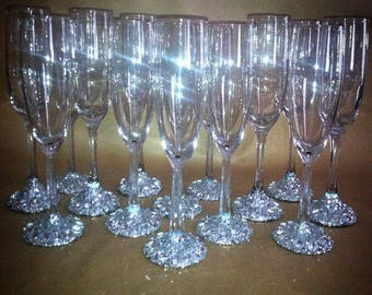100 sparkling glass champagne flutes in increments