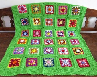 Handmade Crochet Kaleidoscope Kids blanket  / lap afghan granny squares. Approximately 36 inches by 42 inches