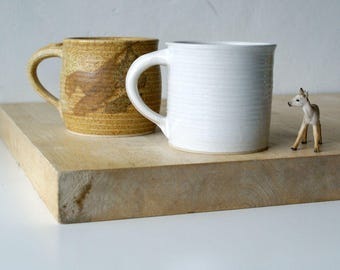 Two mismatched mugs - glazed in brilliant white and natural brown