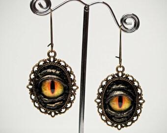Dragon eye black leather earrings. Halloween earrings. Leather earrings. Dangle earrings. LARP. Horror leather jewelry. Gothic earrings.