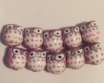 Set of 10 handmade porcelain pink owl beads.