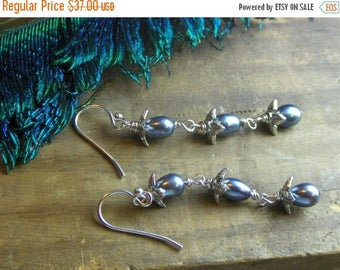 BELTANE DROPS. Peacock blue freshwater and sterling silver dangle earrings