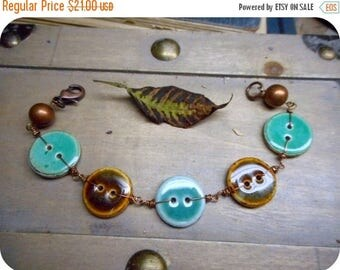 The Folk Button Bracelet.  Ceramic Glazed Teal & Brown Button and Rustic Copper bracelet