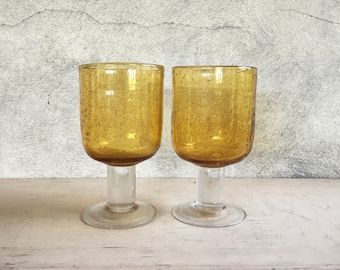 Two vintage Mexican blown glass pedestal goblets amber and clear glass Southwestern decor