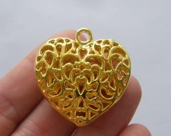 2 Heart pendants gold tone GC182