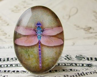Pink dragonfly on textured green, oval handmade glass cabochon, 40x30mm or 25x18mm 30x40mm, handmade in this shop, Winged Wonders series