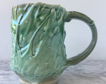 Stoneware mug with porcelain slip drips, wabi sabi drinking vessel light blue glazed pottery cup