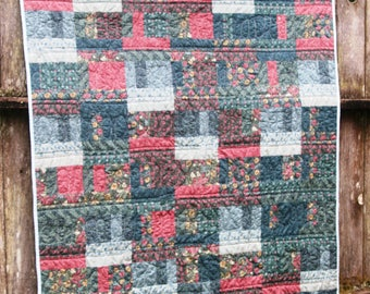 William Morris blue, green and rose lap, patchwork quilt coverlet.