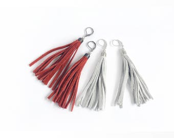 Leather tassel earrings in tomato red and light grey