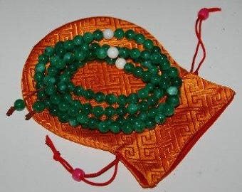 Green Jade Mala with Conch Shell Spacer in a Silk Pouch