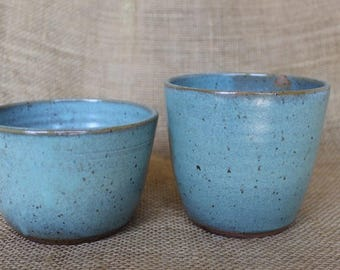 Small wheel thrown speckled stoneware jars