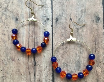 Clear orange and navy beaded hoop earrings