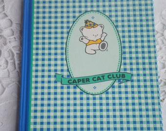 1991 Caper Cat Club Notebook. Hardcovers. 36 sheets in green, purple and pink. 72 pages.