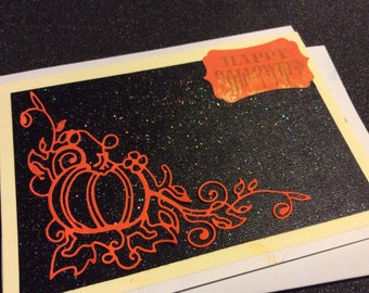 Happy  Halloween greetings card, handmade card, hand stamped, pumpkin with vines cutout, black glitter background