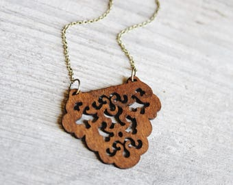boheme. a long bronze and wooden filigree pendant statement necklace