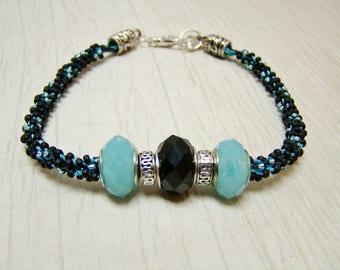 Blue and black Kumihimo sead bead large hole glass sterling beaded bracelet