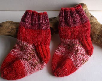 Unisex  hand knitted self patterning socks. Red shades 9 to 18 months. UK 3  EU 19  US 3.5