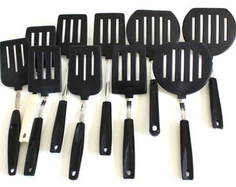 Plastic Spatulas: Ekco Round Pancake Turner, Ekco Short Handle; No Brand White Handle Korea; Unmarked Black Handle
