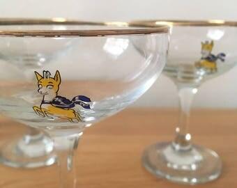 Two vintage babycham glasses