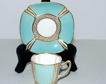 Copeland Spode for Theodore B Starr  demitasse cup and saucer turquoise  and gold fine china hand painted