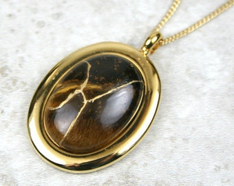Kintsugi (kintsukuroi) tiger eye stone cabochon with gold repair in a gold plated setting on gold chain - OOAK