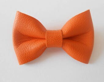 Orange leather knot of 4.5 x 3 cms hand-made