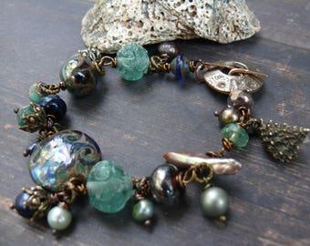 Pirates of the Caribbean - Salazar's Revenge  -  OOAK lampwork pearl bronze czech glass bracelet in ocean colours.