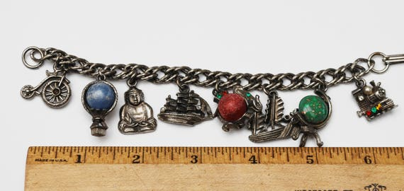 Silver Travel Charm bracelet - signed Leru - silver tone - traving charms boats,air ballon,globe bicycle ,Buddha charms