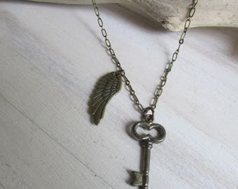 Key and angel wing necklace