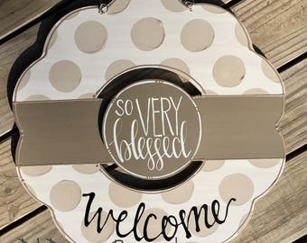 neutral wreath door hanger with polka dots and hand lettering