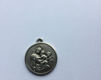 Beautiful silver religious vintage Mary and Jesus medal