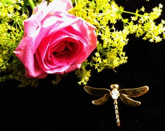 Gold tone small dragonfly brooch with white rhinestone centre