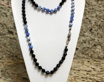 Black with blue Agate  Hand Knotted Necklace with Sterling silver clasp and matching earrings.