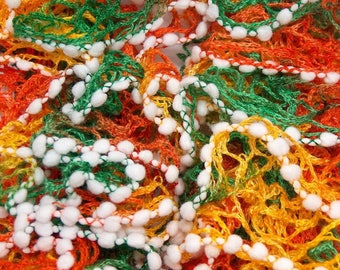 scarf ruffle color orange/green/yellow border pompons white