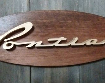 1956 Pontiac Emblem Oval Wall Plaque-Unique scroll saw automotive art created from wood for your garage, shop or man cave.