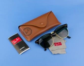 0e65911a6f Ad Ray-Ban Clubmaster Sunglasses and Pouch Black Gold Vintage