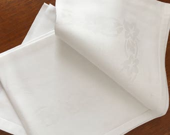 Two large white damask napkins
