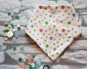 Polka dot dribble bib with cream background