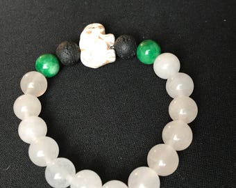 7 1/2 inch white and green jade bracelet withlava stones. White turquoise elephant accent bead .