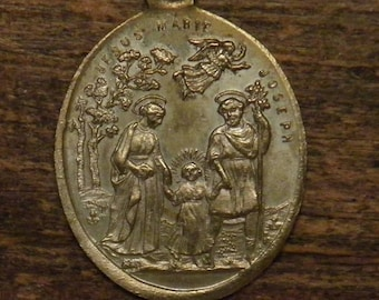 Antique religious bronze medal pendant the holy family Joseph Mary Jesus with angel