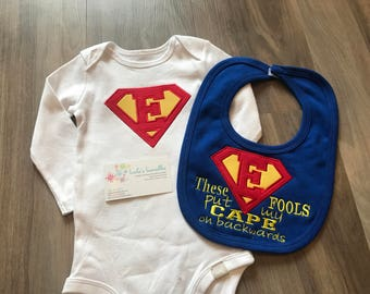 These fools put my cape on backwards, superman inspired onesie, canada, superhero, personalized baby bib, velcro bib, cute saying.