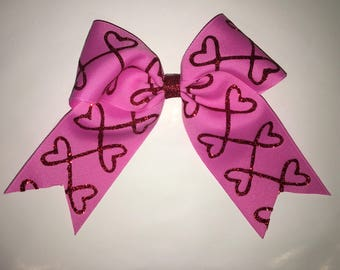 Red Glitter hearts on a pink, Valentine's cheer bow