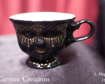 136 - Gold Dot Mask on Black Background, 3 inch Ceramic Doll Face Tea Cup
