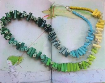 Wooden long necklace with colored pencils in shades of yellow, blue and green