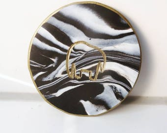 Black and white marble pattern jewelry dish with a elephant detail