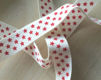 "decorative Ribbon: ""red stars"" on an ecru background"