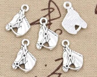 X 2 silver horse head Tibetan 17mm