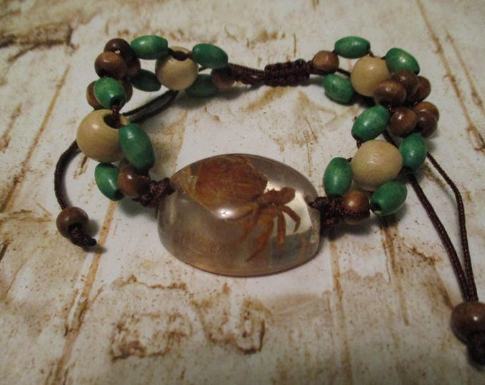 Crab in Clear Lucite Bracelet Wood Beads Slipknot Brown Green White wood beads.